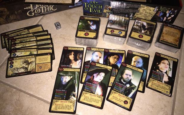 Here is closer look at the contents. There are hero cards, villain cards, and masses of regular cards for the decks.