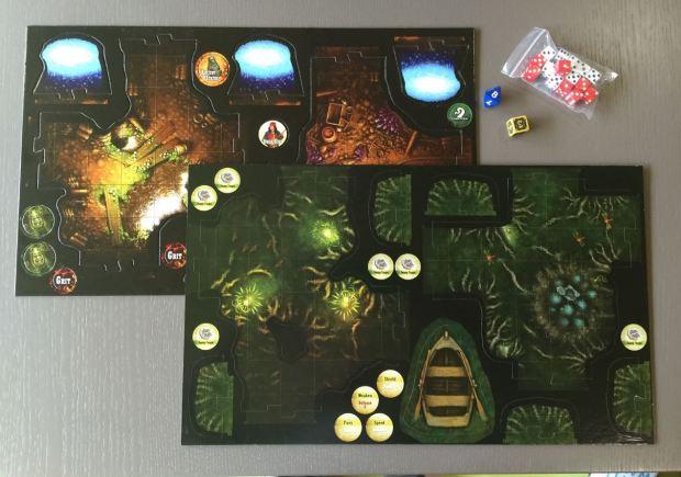 The map tiles are all sorts of shapes that fit together like a jigsaw to make up the game board as you explore. Here are a few of the tiles waiting to be punched out.