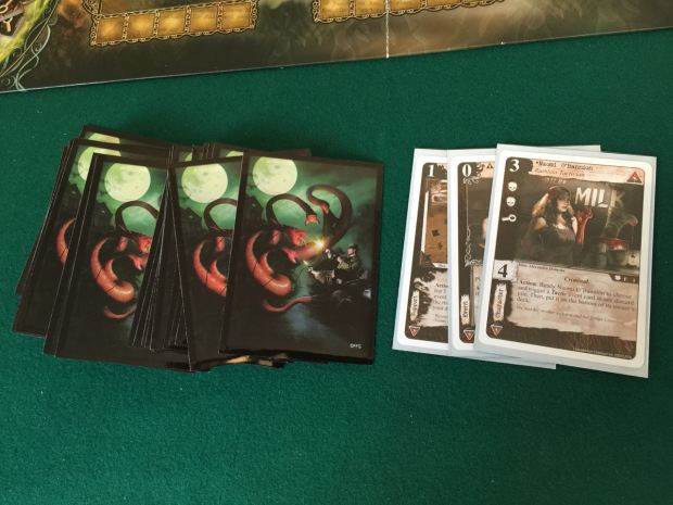 I put my new Syndicate criminals deck in the sleeves with the picture from the Arkham Horror box