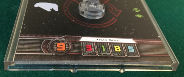 The pilot skill is shown by the big orange number. Han Solo has the maximum possible, a 9.