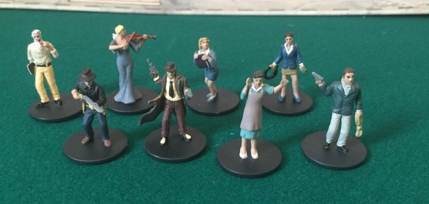 You do not get these figures with the game. These are part of the full set of Arkham Horror investigator miniatures. They have the same characters in both games.