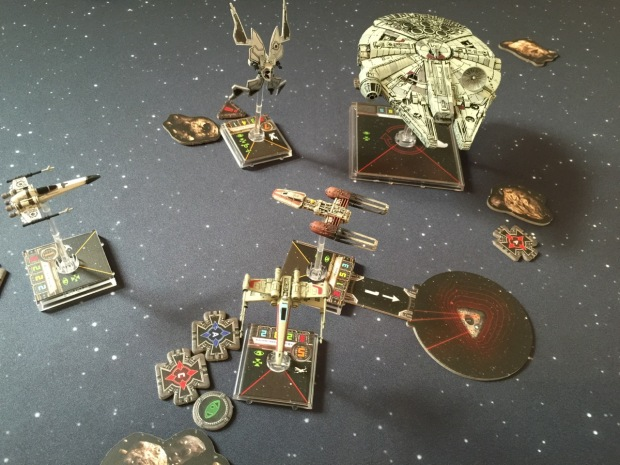 The Y-Wing drops a proximity bomb directly in front of the Falcon.