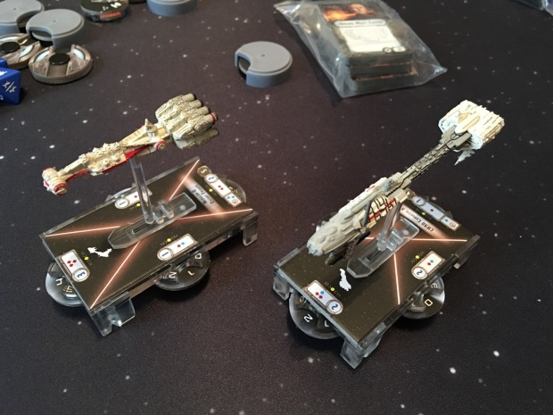 The two rebel ships on their bases. Ships can fire in all directions, so they have four firing arcs.