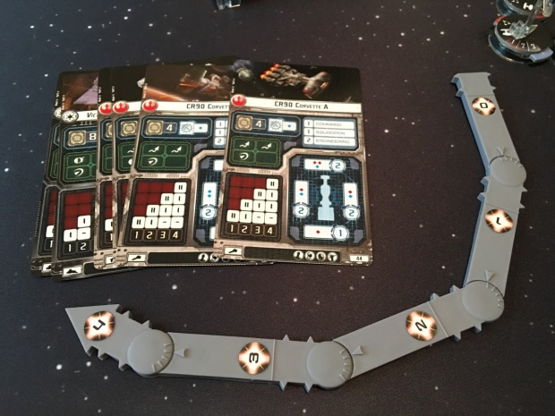 Ship cards and the movement template. There is only one template, unlike the many in X-Wing, but it is a bit more complicated.