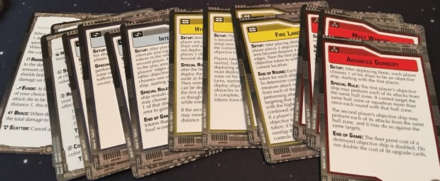 The objective cards. Most of these have rules for how to score points in the game. There are a variety of different types including 'capture the flag' kind of games.
